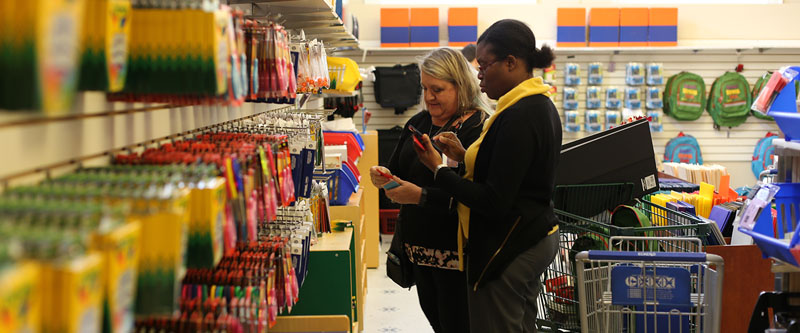 Two teachers in Teaching Tools Resource Center, picking out supplies in room, Hillsborough Education Foundation