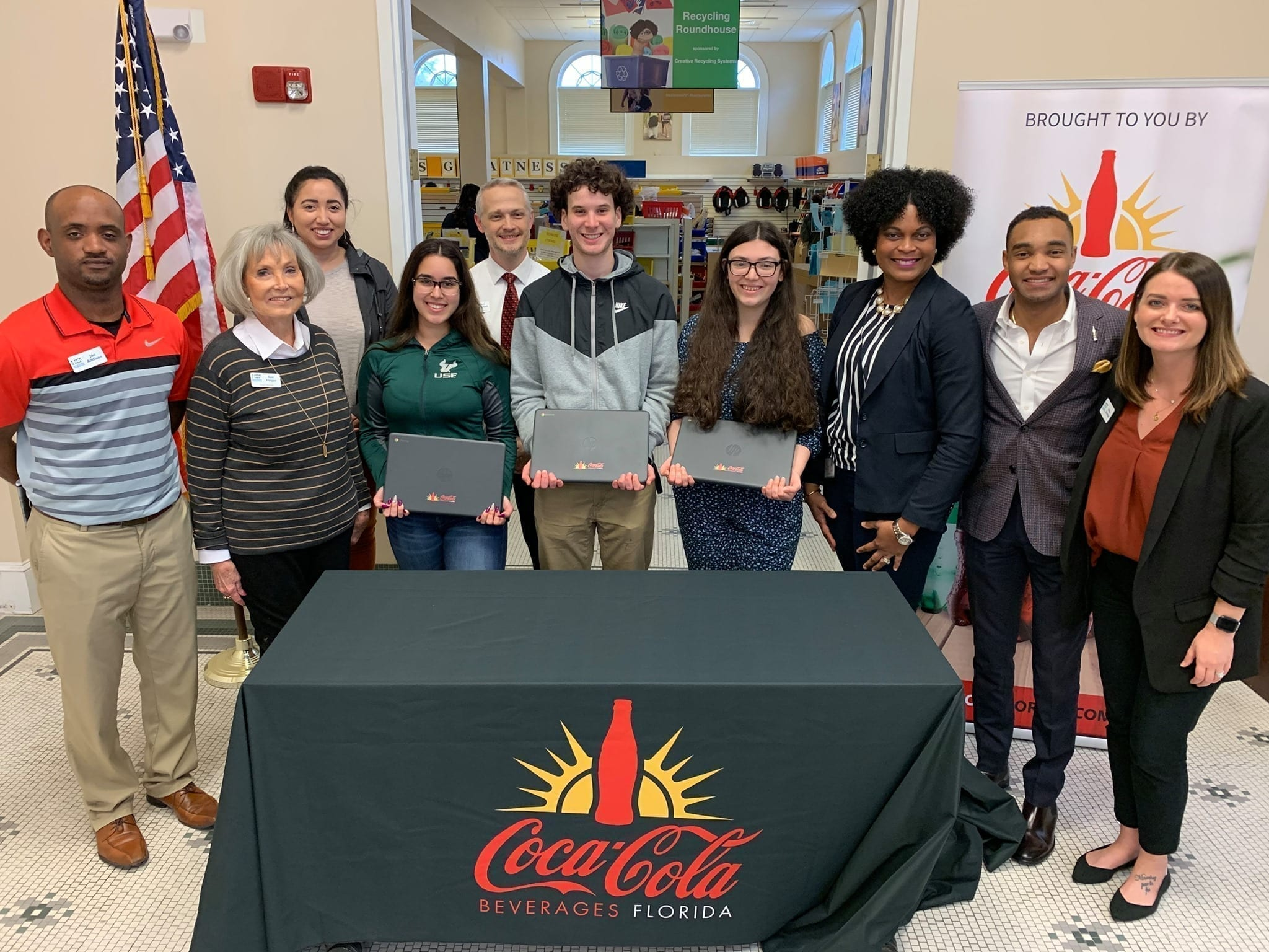 Representatives from Coke Florida present laptops to three Take Stock in Children mentoring students and Hillsborough Education Foundation Take Stock in Children team